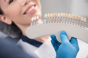 a person getting fitted for dental veneers tx