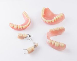 pairs of both partial dentures and full dentures