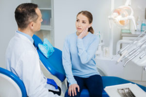 woman in need of root canal treatment