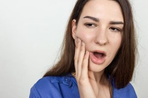 woman struggles with teeth grinding